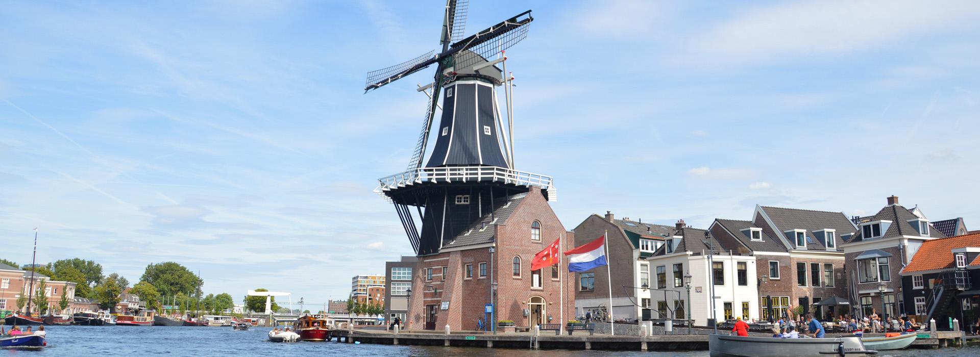 dutch windmill by the river in haarlem
