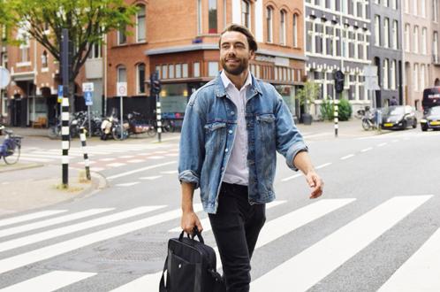 man walking through streets of amsterdam