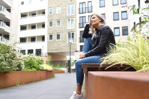woman sitting in backyard of residential area