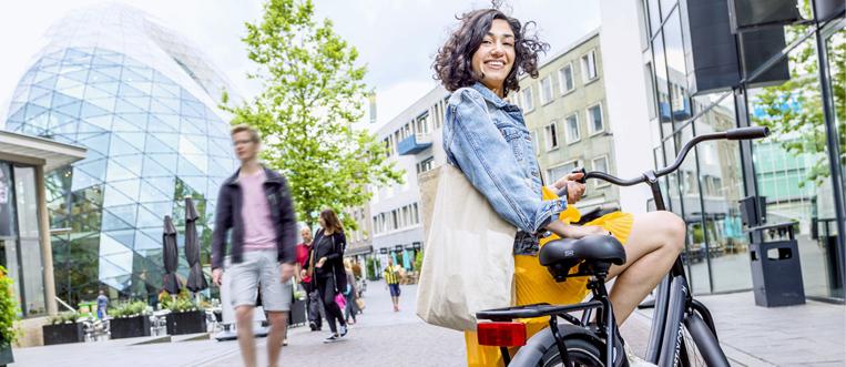 girl on bike city center Eindhoven