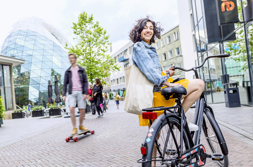 woman with bike in vibrant city of eindhoven
