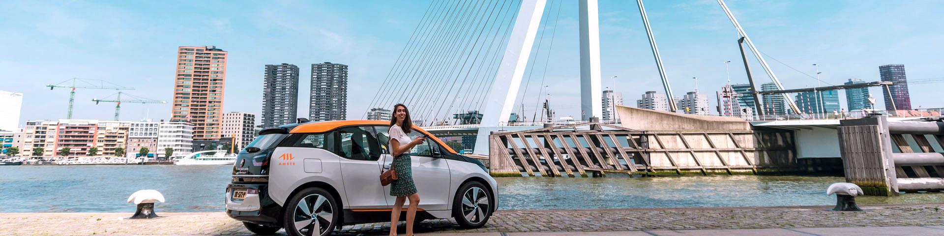 Amber car in Rotterdam in front of Erasmus bridge