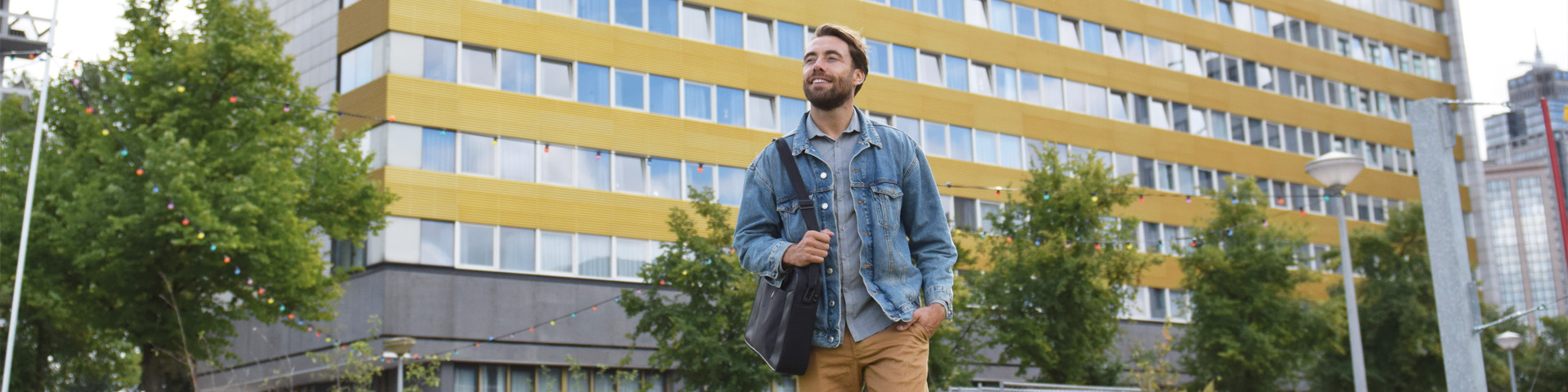 man in front of building Europahuis in Amsterdam
