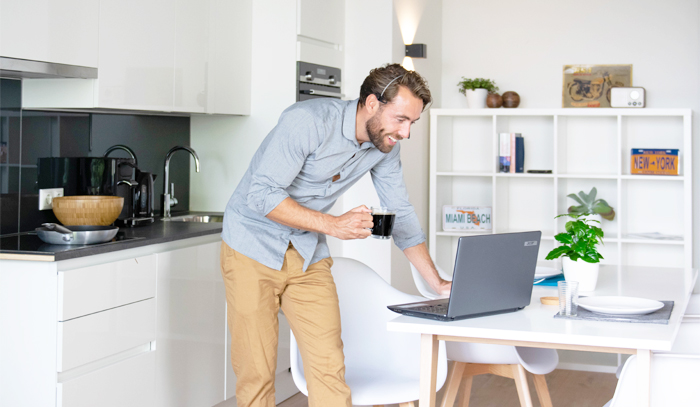 tenant looking at laptop in kitchen