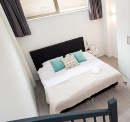 cozy bedroom under plateau