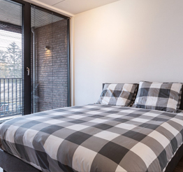 cozy bedroom with private balcony