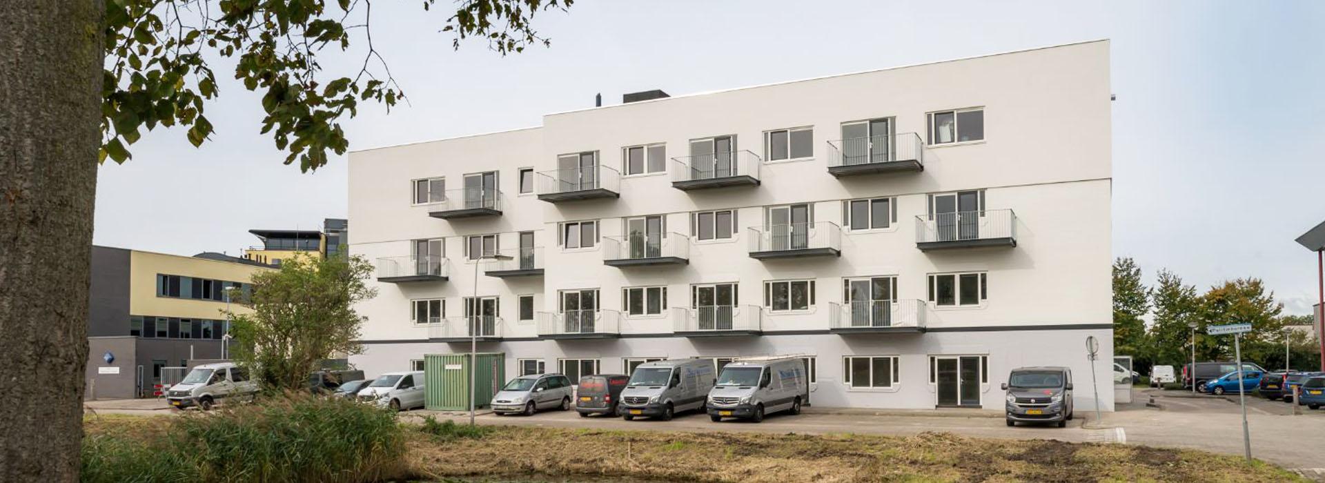white residential building limawonen