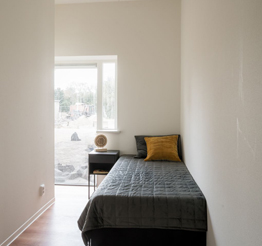 spare bedroom with floor to ceiling windows