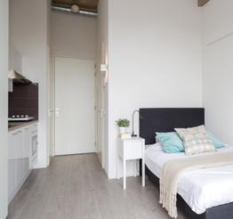 single bed in studio apartment