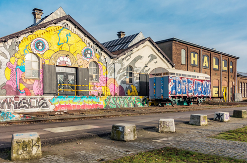 urban industrial area decorated with graffiti