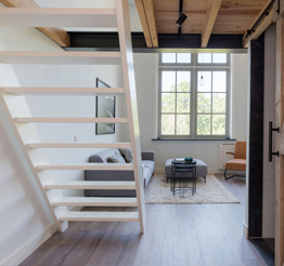 loft apartment with barn doors and wooden stairs