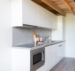 modern kitchen with concrete backsplash
