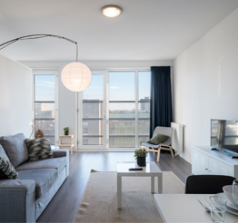 white living room in The Y in The Hague with floor to ceiling windows
