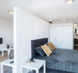 studio apartment bedroom divided with wall