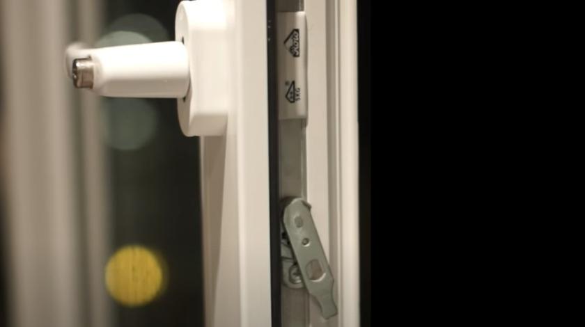 Metal levers on side of window